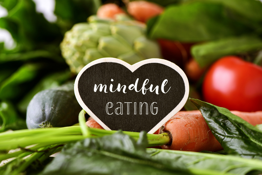 mindful eating written on sign amidst fresh vegetables